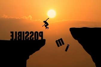 man-jumping-over-impossible-or-possible-over-cliff-on-sunset-background-business-concept-idea_1323-265